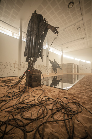 view of oilpool, 'Casting a Dark Democracy' by Tim Shaw